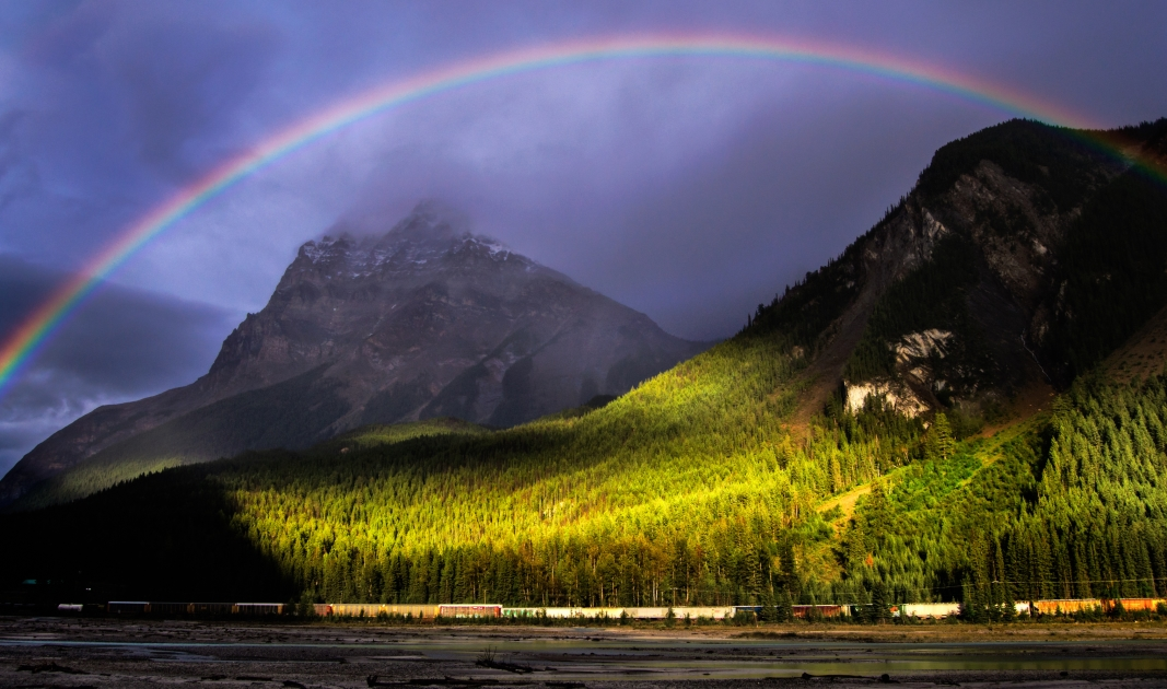 A rainbow over Yoho National Park in British Columbia