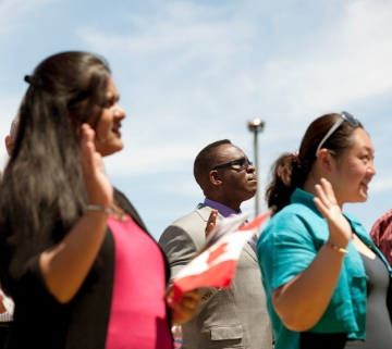 New Canadian citizens being sworn in at a citizenship ceremony