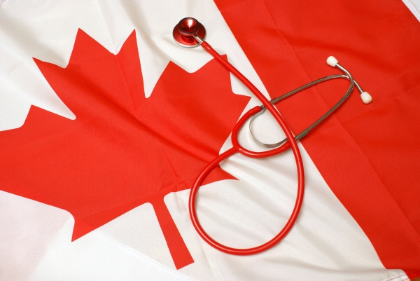 A Canadian flag with a stethoscope resting on it