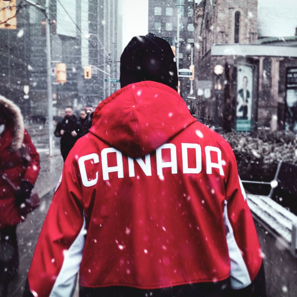 Man wearing Canada jacket in the winter