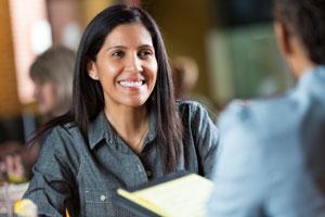 Express Entry candidates: A smiling woman being interviewed for a job
