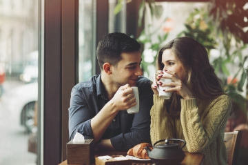 A couple drinking coffee in a cafe