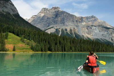 Two people kayaking on Emerald Lake, Alberta, Canada