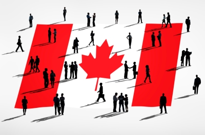 Figures gathered on a Canadian flag