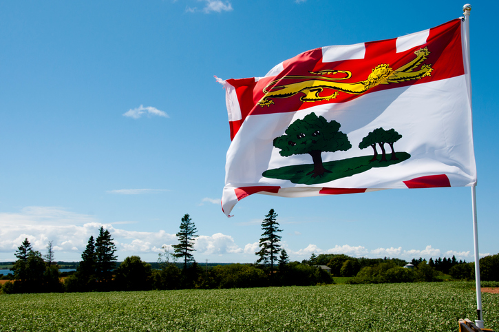 The flag of Prince Edward Island fluttering in a summer day.