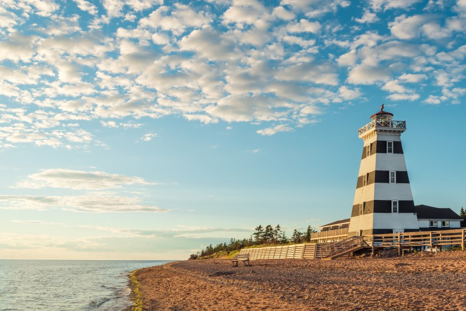 An image of a lighthouse in Cedar Dunes Provincial Park in Prince Edward Island, Canada.