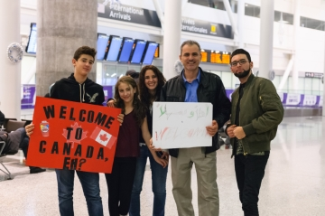 A welcome party for Syrian refugees landing in Canada