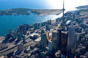 A bird's eye view of downtown Toronto, showing the CN Tower and Toronto Island on a clear day