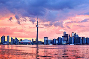 The skyline of Toronto, Ontario, Canada from Lake Ontario, showing the CN Tower and other large city buildings
