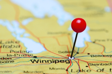 A map of Manitoba, Canada, with a pin stuck in the capital city, Winnipeg